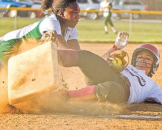 Ursuline's Brianna Curd (1) successfully tags out Boardman's Angela Martin (9) on her way to third base during the sixth inning of a game Thursday at Candlelight Knolls in Bazetta. The Spartans went on to defeat the Irish, 3-0, behind sophomore pitcher Nicola Gabriele, below.