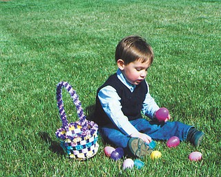 2-year-old Nicholas Rolfi is trying to find out whatÕs inside of these colorful eggs. He is the son of Tony and Janice Rolfi of St. Louis, Mo., and the grandson of Rich and Irene Makovec of Struthers..