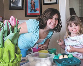 Malina Seil and her big sister, Alyssa Vivacqua, enjoy coloring Easter eggs. Parents are Dave and Joanne Seil and Mark Vivacqua, all of Boardman..