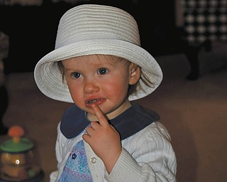 Cora Rodgers of Beaver, Pa., was 17 months old in this Easter 2009 picture. She is baby signing ÒI need a cookie.Ó She is the granddaughter of Carol and Dan Shields.of Canfield.