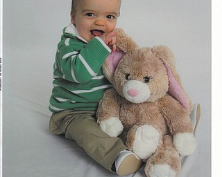 James George Lipanic, 7 months old, of Boardman, thought this bunny looked good enough to eat on his first Easter..