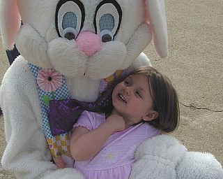 Brianna Hall, 3, daughter of Eric Hall of Boardman, is taking a break with the Easter Bunny in this March 2007 picture..