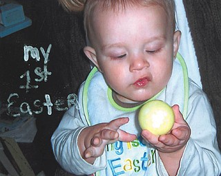 Xavier Klamer of Newton Falls inspects a colorful egg on his first Easter in 2009.