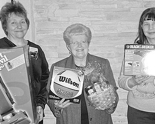 The Vindicator: Displaying a few of the items to be featured at a Chinese auction at Ursuline Center on April 18 are members of Mill Creek Chapter of the ABWA, from left, Kathy Novak; Judy Codespote, chapter president; and Joyce Billock.
