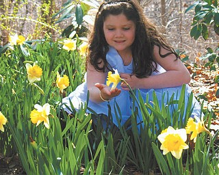 This is Julie Carino, 8, at Fellows Riverside Garden. Sent by her mom, Gayle Carino of Austintown.
