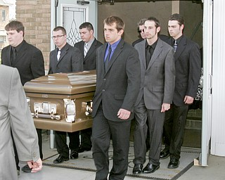 William D. Lewis | The Vindicator  Pallbearers carry the casket o during funeral service for Joshua Sherbourne, one of 3 Marine recruits, killed in a traffic accident. Services were held at Carl W. Hall Funeral Home in Warren Monday..