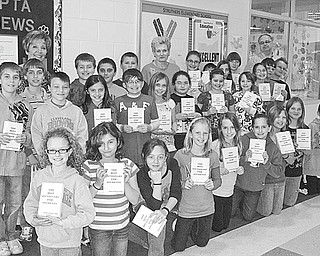 The Vindicator: Fourth-grade students at Struthers Elementary School display dictionaries given to them by Struthers Rotary Club. The books were distributed as part of the club's literacy project, in an effort to aid students with home and school work, to build a frame of reference and to give them a better understanding of the world. The club distributed more than 300 dictionaries to fourth-graders at area schools.