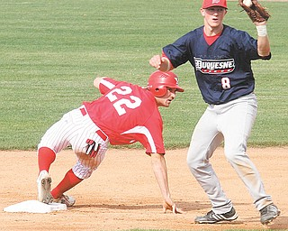 Youngstown State's Tom Clayton (22) and Andrew Heck (8) of Duquesne wait for the official ruling on a close play at second base during Wednesday's game at Eastwood Field in Niles. Clayton was safe, and the Penguins went on to win 22-8.