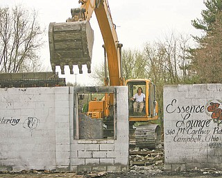 Cosmo Iamurri, owner of Pro Quality Land Development in Campbell, tears down the Essence Lounge on U.S. Route 422. Iamurri did the razing in return for some city land near his business.