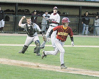 Boardman catcher Dan Popio, left, throws out Dan Reese of Cardinal Mooney at first base during Monday's game at Cene Park.