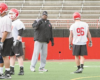 Youngstown State assistant football coach Ron Stoops said the transition to coaching college players after so many years in high school is getting easier every day.