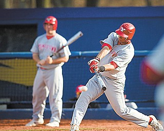 Geoffrey Hauschild|The Vindicator.YSU's Jeremy Banks (3) hits a single during the top of the ninth inning of a game at Kent State's Schoonover Stadium on Wednesday afternoon.