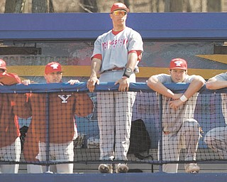 Geoffrey Hauschild|The Vindicator.YSU's Jeremy Banks (3) stands center among teamates during the third inning of a game at Kent State's Schoonover Stadium on Wednesday afternoon.