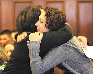Nicolette Simkins of Meridian Services, right, gives a congratulatory hug to one of the graduates at the drug-court graduation ceremony at Mahoning County Common Pleas Court. Six people completed the requirements and graduated from the program Wednesday.