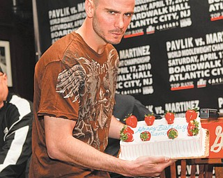 WBC/WBO middleweight champion Kelly Pavlik poses for a picture with a birthday cake for his 28th birthday at a news conference in New York, Wednesday, April 14, 2010.  Pavlik was there to promote his fight against WBC super welterweight champion Sergio Martinez on Saturday, Apr. 17, 2010. (AP Photo/Seth Wenig)
