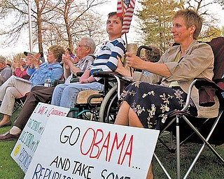 "The Vindicator|Geoffrey Hauschild.Candy Davis, of Boardman, listens to speakers next to her daughter Abbey, 19, who sits in a wheelchair due to a disability during a TEA Party event on the green in Canfield on Thursday evening. ""I think its important to try to improve the condition of the country and there are some good ideas,"" said Davis. ""I don't think there is a place for the government or the employer in Health Care, I just want it to be affordable like my house insurance or car insurance."""