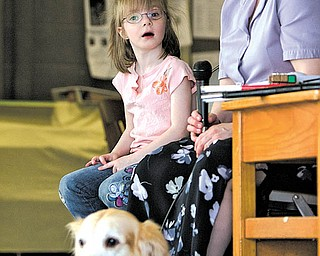 Geoffrey Hauschild|The Vindicator.Tracie Reiser speaks to students at Watson Elementary about living with a vision disability accompanied by  Faith Sylvester, 5, a student at the school who lives with impaired vision and Reiser's guide dog, Jimi, a golden retreiver, while in Austintown on Thursday afternoon.
