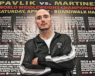 "World middleweight boxing champion Kelly ""The Ghost"" Pavlik of Youngstown poses in front of a banner touting his upcoming title fight against WBC super welterweight champion Sergio Martinez of Argentina during Media Day on Thursday at the historic Boardwalk Hall in Atlantic City, N.J. Top Rank, in association with DiBella Entertainment and Caesars Atlantic City, is promoting Saturday's fight, which will air on HBO World Championship Boxing."