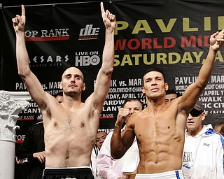 4/16/10,Atlantic City,N.J.   --- (L-R)  World Middleweight Champion Kelly Pavlik, Youngstown,Ohio and WBC Super Welterweight Champion Sergio Martinez of Spain pose during the weighin Friday for their upcoming World Middleweight Championship at the historic Boardwalk Hall in Atlantic City,NJ on Saturday, April 17. Top Rank is promoting in association with DiBella Entertainment and Caesars Atlantic City. Pavlik vs Martinez will be televised on HBO World Championship Boxing.  --- Photo Credit : Chris Farina - Top Rank  (no other credit allowed)  copyright 2010