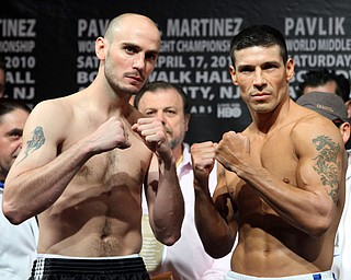 Kelly Pavlik of Youngstown, OhIO, left, and Sergio Martinez of Argentina pose after their weigh-in for a  WBC middleweight championship fight, Friday, April 16, 2010,  in Atlantic City, N.J.  (AP Photo/Sean M. Fitzgerald)