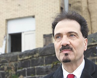Richard Scarsella, historic-preservation promoter, is the man behind Sacred Places Dialogue, a movement about preserving or re-inventing places of worship. He's standing in front of the closed St. Mary's Byzantine Church on Salt Springs Road, Youngstown, which has housed various congregations. An individual now owns the building, which is in disrepair.