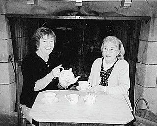 Marge Gollner, left, and Rae Jeanne Mollica are serving as co-chairwomen of the Austintown Historical Society's 17th annual High Tea that will take place Sunday at the Strock Stone House.