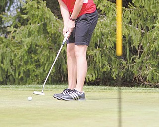Youngstown State junior golfer Katie Rogner eyes a putt during a recent practice at Pine Lakes Country Club in Hubbard.