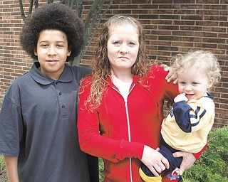 Nicole Binion of Warren stands with her 13-year-old son Marquise,  .left, and her 21-month-old son Eli'jah outside of St. Demetrios  .Banquet Hall in Warren, where Nicole was honored for Rising Up and  .Moving On from a past that included drug addiction and prostitution  .to regain custody of Eli'jah and re-establish her relationship with  .Marquise.