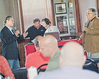 State Rep. Robert F. Hagan, left, and Don L. Hanni III, right, his Democratic opponent in the 60th Ohio House District primary, discuss their qualifications during a candidates forum sponsored by WKBN radio. WKBN talk-show hosts Ron Verb, second from left, and Dan Rivers helped organize Wednesday's event.