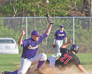Champion's Billy Wartz (12) bobbles the ball, allowing Girard's Michael Floravit (21) to slide safely into second base in the bottom of the sixth during Wednesday's game in Girard. The game was tied 4-4 until the bottom of the fifth when a single by Aaron Jennigs put the Indians ahead 6-4. They went on to win 7-4.