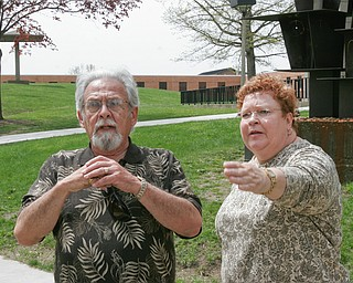 Harvey Kayne, a Valley resident who was a graduate student at Kent State on May 4, 1970 when 4 students were killed by Ohio National Guard gunfire, stands near the site on the Kent campus. At right is Jane Doughton who was student at Kent at the time.