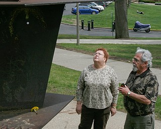 Harvey Kayne, a Valley resident who was a graduate student at Kent State on May 4, 1970 when 4 students were killed by Ohio National Guard gunfire, stands near the site on the Kent State campus. At left is Jane Doughton who was student at Kent at the time. The sculpture in foreground was hit by gunfire.