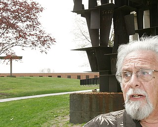 Harvey Kayne, a Valley resident who was a graduate student at Kent State on May 4, 1970 when 4 students were killed by Ohio National Guard gunfire, stands near the site on the Kent State campus. the sculpture in background was hit by gunfire.