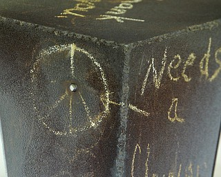 Close-up of of a bullet hole in a sculpture hit by gunfire at Kent State on May 4, 1970.