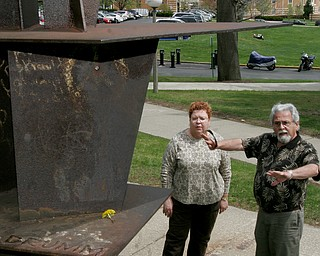 Harvey Kayne, a Valley resident who was a graduate student at Kent State on May 4, 1970 when 4 students were killed by Ohio National Guard gunfire, stands near the site on the KSU campus. At left is Jane Doughton who was student at Kent at the time. The sculpture in foreground was hit by gunfire.