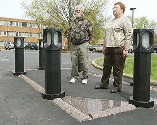 Harvey Kayne, a Valley resident who was a graduate student at Kent State on May 4, 1970 when 4 students were killed by Ohio National Guard gunfire, stands near the site of the shooting on the Kent State campus. At left is Jane Doughton who was student at Kent at the time.