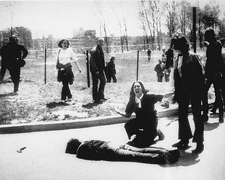 """Mary Ann Vecchio gestures and screams as she kneels by the body of a student lying face down on the campus of Kent State University, Kent, Ohio on May 4, 1970. A static-filled recording was released Tuesday May 1, 2007 of the 1970 Kent State University shooting that killed four students raising questions not only about whether someone called on National Guardsmen to fire, but also who might have given the order. The tape was released by Alan Canfora, 58, one of nine students wounded in the 1970 shootings. He played two versions of the tape _ the original and an amplified version _ in which he says a Guard officer issues the command, """"Right here! Get Set! Point! Fire!"""""""