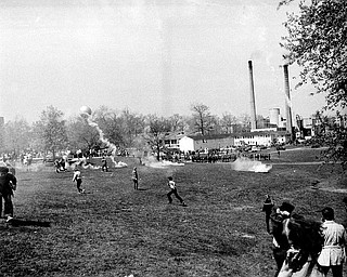 Ohio National Guardsmen throw tear gas at students across the campus lawn at Kent State University during an anti-Vietnam War demonstration at the university on May 4, 1970. The Guard killed four students and wounded nine. (AP Photo)