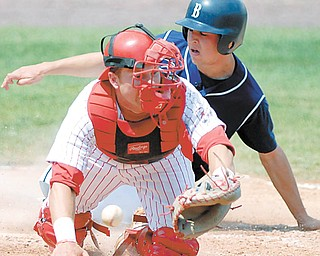 Butler's Andrew Eckhardt (2) comes into home plate to score as Youngstown State catcher Jonathan Crist (4) misplays the ball on a throw during a game Sunday at Eastwood Field. The teams played a twinbill, with the Bulldogs winning the first game, 9-8, and the Penguins taking the second, 10-6.