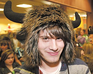 Neal Worman, a junior from Mohawk High School, Bessemer, Pa., donned this unusual headgear Wednesday for the 32nd annual English Festival at Youngstown State University. He said his hat helps him perform.