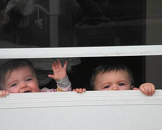 The Colla twins, Nicholas and Lia, 9 months old, are the children of Nick and Nadine Colla of Boardman. Mom says they have spring fever and were trying to get outside to enjoy the great weather.