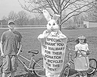 The Kiwanis Club of Western Mahoning County hid 2,000 filled eggs at Liberty Park in North Jackson, where 96 youngsters participated in an egg hunt April 3. The Easter Bunny (Alexis Millereile of North Jackson and a Key Club member) holds a sign thanking Wal-Mart for donating bicycles to be awarded as prizes at the event. Ready to hop on the bikes they won are, from left, Zach Gerthan and Ally Vouvalis of Boardman.