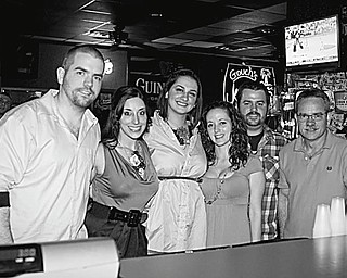 """The FrockOn LLC, a fashion social networking site, teamed up with Slim's Bar and Grille, 2844 Market St., to present an evening of live music, fashions and blue drink specials April 3 as a benefit for the Rescue Mission. Working together to make the """"Chasing the Blues"""" event a success are members of FrockOn, shown above as they pose with the grille owners ."""