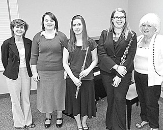 Students minoring in music at Youngstown State University presented a recital after the April 18 business meeting of Youngstown Music Teachers Association at Old North Church in Canfield. Coordinating the program were, at left above, Diane Yazvac, YMTA president-elect, and at right Audrey Rhinehart, YMTA president, who share the spotlight with the musicians, from left, Abigail Margraff (piano), Heidi Keener (flute) and Melissa Gatsby (clarinet).