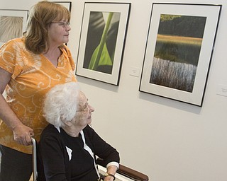 "LISA-ANN ISHIHARA | THE VINDICATOR ..Nancy Nuzzi of Liberty takes Mrs. Amanda Flynn from Part Vista North on a stroll through The Butler Institute of American Art, as they pass ""Michael Cole Outside/In: Photographs"" exhibit, Sunday, May 2, 2010"