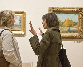 "LISA-ANN ISHIHARA | THE VINDICATOR ..L-R Ginny Hazy of Hubbard and Hannah Moses of Hermitage, PA discuss the artwork of Amercan Impressionist Robert Vonnoh at The Butler Institute of American Art. The Butler owns ""In Flanders Field"" with the rest of the pieces being on loan, Sunday, May 2, 2010"