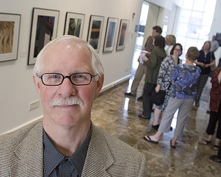 "LISA-ANN ISHIHARA | THE VINDICATOR ..Michael Cole poses in front of his exhibit ""Outside/In: Photographs"" exhibit at The Butler Institute of American Art, Sunday, May 2, 2010"