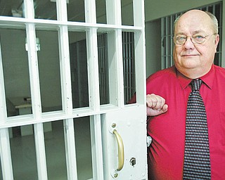 Bob Norris, 59, longtime Struthers police chief, stands near the city jail cell. He retires at the end of this month, ending a law-enforcement career that began in 1975.