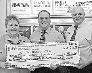 Western Reserve Restaurant Management Group, the owner/operator of 29 Wendy's restaurants in Cuyahoga and Lorain counties, presented a check for $122,119 to Northeast Ohio Adoption Services on April 7, bringing their total contribution to $849.345 over the past 10 years. Shown during the presentation of a symbolic check are, from left, Cynthia Deal of NOAS; Randy Writz, area director of the management group, who made the presentation; and Jason Truxall, manager of the top selling St. Clair Wendy's.