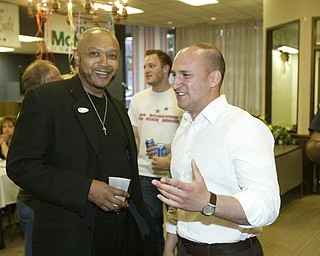 William D Lewis The Vindicator  Joe Schiavoni, right, talks with Rev Kenneth simon, pastor of New Bethel Church during party at Mahoning Plaza tuesday night.